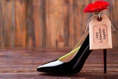 Бирка и ботинок дня ` s женщин Стоковые Фотографии RF