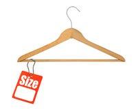 бирка размера вешалки пальто Стоковое Фото