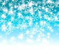 бирюза снежинки bokeh предпосылки Стоковая Фотография RF
