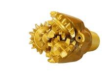 Бит утеса золотого цвета Tricone сверля изолированный на белизне стоковые фото