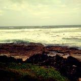 Благоустраивать захода солнца пляжа изумляя Стоковые Фото