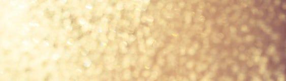 Блеск золота освещает замороженное bokeh снега Стоковое Фото