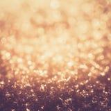 Блеск золота освещает замороженное bokeh снега Стоковая Фотография RF