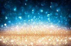 Блестящее влияние с золотым и голубым Bokeh Стоковые Изображения