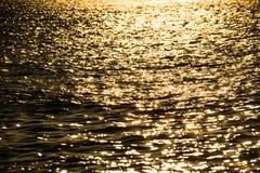 Блестящее море в заходе солнца Стоковое Изображение