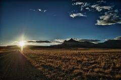 блеф над заходом солнца Стоковая Фотография