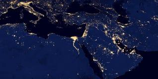 Ближний Восток, западная Азия, восточная Европа освещает во время ночи по мере того как оно выглядеть как от космоса Элементы это стоковое фото
