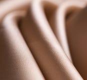 близкая сатинировка ткани вверх Стоковые Изображения