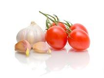 близкие томаты чеснока вверх Стоковое Изображение RF