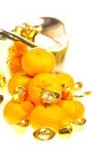 близкие tangerines золотых инготов вверх Стоковое фото RF