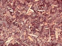 Близкий взгляд на mulch расшивы, предпосылке природы в ретро взгляде Стоковые Изображения RF
