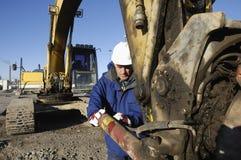 близкий водитель землекопа поднимает Стоковое фото RF