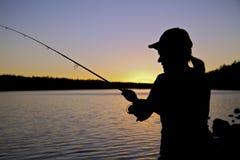 близкий заход солнца рыболовства вверх Стоковые Фото