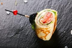Блинчик с семгами стоковые фото