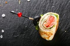 Блинчик с семгами стоковое изображение