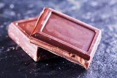 Блоки шоколада над черным камнем Стоковое Изображение RF