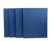 блокноты сини 4 изолированные Стоковая Фотография