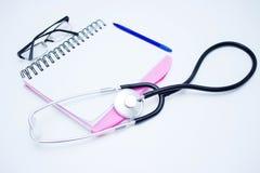 Блокнот доктора на белой предпосылке Текстура и предпосылка стоковая фотография