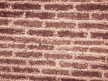 Блок и гравий камня Laterite бросаются картина в фене границы стоковая фотография