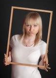 Блондинка в деревянной рамке Стоковые Изображения RF
