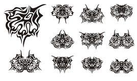 Богато украшенные символы лапки и бабочки от его Стоковая Фотография