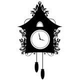 Богато украшенный силуэт часов с кукушкой Стоковое фото RF