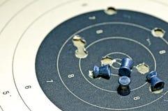Боеприпасы воздушной пушки с бумагой цели Стоковые Фотографии RF