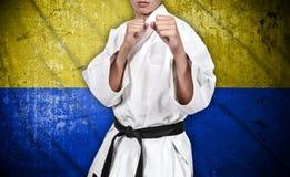 Боец карате и флаг Украины Стоковые Фото
