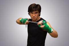 Боец с зелеными повязками Стоковое Изображение RF