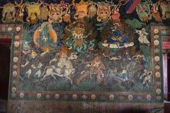 Божества протектора тибетского буддиста, фрески, настенной живописи монастыря Nechung, Лхасы, Тибета стоковая фотография