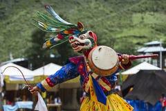 Божество льва снега главное, бутанский танец маски Cham, Бутан стоковое изображение