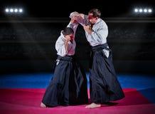 Бойцы боевых искусств на зале спорт Стоковые Фотографии RF