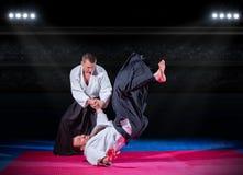 Бойцы боевых искусств на зале спорт Стоковая Фотография