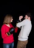 Бой женщины и человека Стоковая Фотография