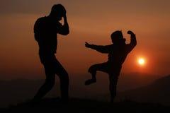 Бой на заходе солнца Стоковые Фото