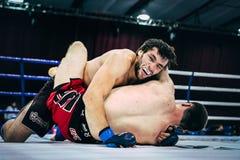 2 бой Muttahida Majlis-E-Amal спортсменов земных Стоковое фото RF