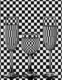 Бокалы на checkered предпосылке Стоковые Фотографии RF