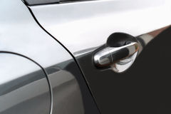 Боковая дверь черного автомобиля используемого как ручка для того чтобы раскрыть дверь Стоковые Фото