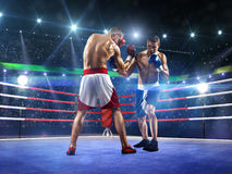 2 боксера professionl воюют на арене Стоковое фото RF