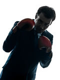Боксер бизнесмена с силуэтом перчаток бокса Стоковая Фотография