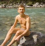 более lussier усаживание утеса реки человека Стоковые Фотографии RF