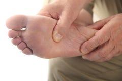 болея нога проверок его человек Стоковое фото RF