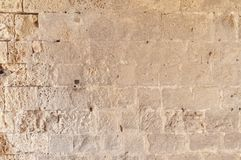Большая старая пакостная каменная стена замка любит каменные обои Стоковые Изображения