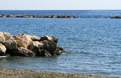 Большие камни в море стоковая фотография