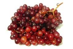 Большие красные виноградины на белой предпосылке Стоковые Изображения RF