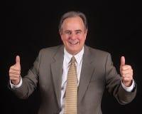 большие пальцы руки бизнесмена возмужалые вверх Стоковое Фото