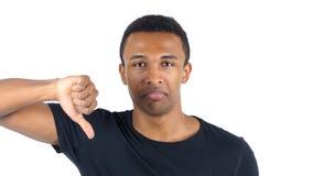 Большие пальцы руки вниз чернокожим человеком стоковая фотография
