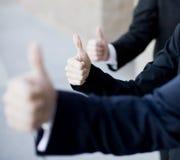 большие пальцы руки дела вверх стоковое фото