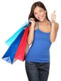 Большие пальцы руки женщины покупкы поднимают успех стоковые изображения rf