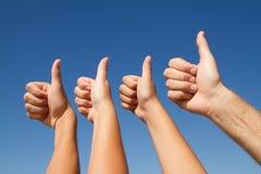 Большие пальцы руки семьи вверх Стоковая Фотография